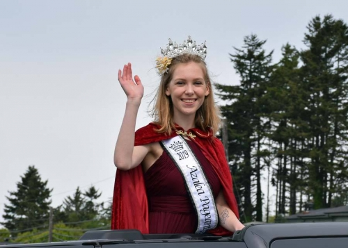 Blonde Teen Azalea Pageant winner 2019 waving to crowd during the Azalea Festival Parade Route